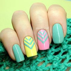 Candy colored spring nail art design. Simple yet very eye catching. Choose your favorite bright spring colors and add simple v-shaped details near the cuticle for effect.