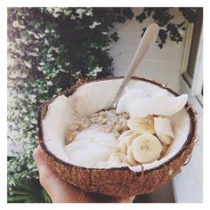 Oats cooked in coconut milk, with coconut yoghurt, fresh coconut flakes, coconut nectar and banana.. Crazy for the coco  #Padgram