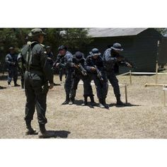 A Jungla from the Columbian National Police observes Tigres trainees Canvas Art - Stocktrek Images (34 x 23)