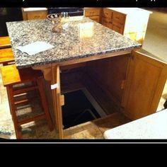 Such a good idea. Secret underground room under kitchen table.