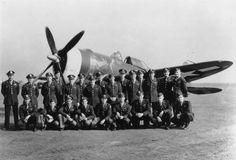 Pilots of the 486th Fighter Squadron, 352nd Fighter Group, in front of P-47 Thunderbolt (PZ-R, serial number 42-8412), named