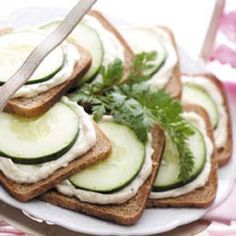 Just mix together a package of cream cheese and dry Good Seasons salad dressing.  Spread on party rye and place a slice of cucumber on top!!  Always a favorite and super easy!!!