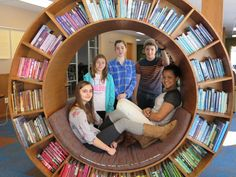 These 8th graders decided to organize the book wheel by the spine color.