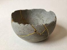 Handmade concrete bowl with a rough hand formed edge that measures 3 across the top. Then I smashed it and put it back together with epoxy and gold dust. One of a kind art piece and definitely a conversation starter! If you dont know anything about kintsugi I highly recommend googling it.