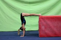 Videos of gymnastics drills coaches can use when teaching gymnasts how to handstand correctly, by Mary Lee Tracy and other gymnastics coaches.