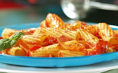 1 box Barilla Rigatoni 2 large yellow onions 2 tbsp extra virgin olive oil 1 clove minced garlic ¼ teaspoon red chili pepper flakes 6 ounces Italian pancetta julienne 28 ounces tomatoes canned 3 cups water ½ cup freshly grated romano cheese ½ cup grated Parmigiano Reggiano 5 leaves fresh basil julienne