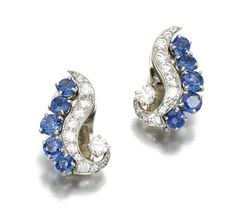 PAIR OF SAPPHIRE AND DIAMOND EAR CLIPS, VAN CLEEF & ARPELS, 1950S.  Set with circular-cut sapphires, circular- and single-cut diamonds, signed Van Cleef & Arpels N.Y. and numbered.