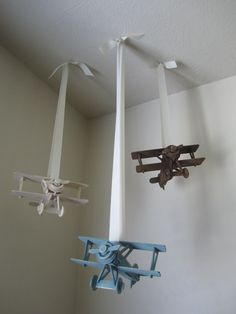 Cute airplanes for a little boys room. Bought each airplane kit for 1 dollar at Michaels, put it together and painted it! Total for whole project 3 dollars! Tied on the ribbon and hung from the ceiling! So cute and so easy!