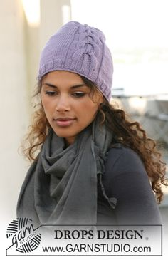 "Knitted DROPS hat with cables in ""Merino Extra Fine"". ~ DROPS Design"