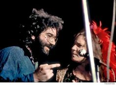 Jerry Garcia talking to Janis Joplin at a stop on the Festival Express, 1970.