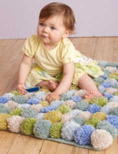 Pom Pom Rug   Lion Brand Yarn OK, quickly: how cute is that baby?! Now that's out of the way, how cute is this rug?! This is one of my favourite posts in a long time. Pom poms are so easy to make, and...