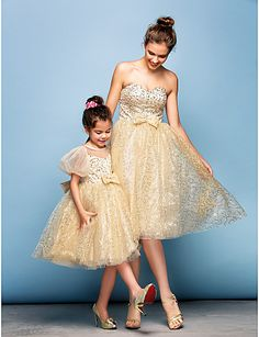 Two stunning mother - daughter style evening dresses in gold glitter at only $135.99. It's time to sparkle!