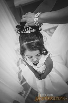 Adorable black and white image of the bride's daughter getting ready for her mother's wedding. Professional wedding photography by Brian C Idocks Photographics. www.briancidocks.com