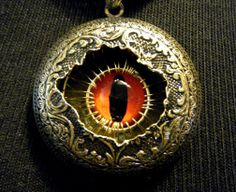 Title: Steampunk Snake Eye Victorian Locket  Inventor: unknown  URL: www.etsy.com  Category: jewelry  Posted by: Dr Brassy Steamington
