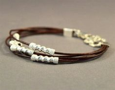 For tiny wrists. A chic leather strands bracelet, alternating with Sterling Silver .925 tubes onto brown, or black, or vintage brown, or black and brown, leather.