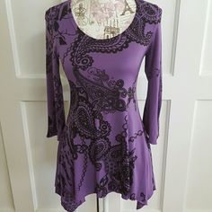 """Miss Pinky Top Purple & Black. Asymmetrical Top. Flared 3/4 Sleeves. Paisley Design. 96% Poly 4% Spandex. Middle length 26""""  Side length 31""""  **Lined iron make on  back R area as in picture #4 Miss Pinky Tops"""