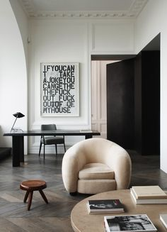 For an apartment in his hometown of Paris, designer Joseph Dirand — pictured on the previous page — combined mid-century pieces by Jean Prouvé (armchair and coffee table), and Charlotte Perriand (stool) with a contemporary painting by Christopher Wool.