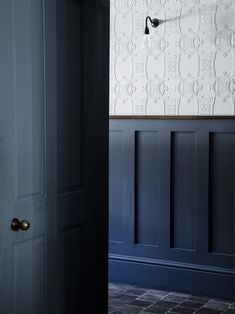 In the main hallway anaglypta wallpaper is combined with painted wooden panelling, edged with a mahogany dado rail. Wooden Panelling, Wooden Wall Panels, Wooden Walls, Wall Panelling, Anaglypta Wallpaper, Hallway Wallpaper, Silver Wallpaper, Wallpaper Ideas, Hallway Wall Colors