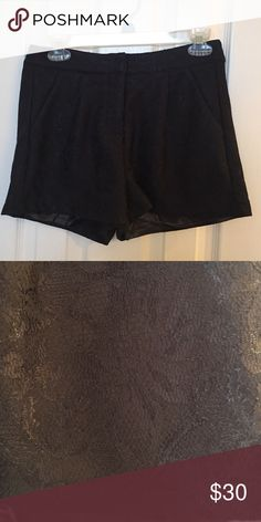 Black lace detailed shorts. Size 25 Beautiful dressy shorts for any occasion. Silk lined on the inside. Thicker material with lace detail. Never worn! New without tags. Shorts