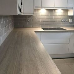 Looking for some white kitchen inspiration? has kindly shared his Bays… Looking for some white kitchen inspiration? has kindly shared his Bayswater Gloss White kitchen renovation. Featuring: Grey Oak Effect Laminate worktop and Grey Granite Composite Sink White Kitchen Inspiration, White Gloss Kitchen, Kitchen Grey, Kitchen Modern, Minimal Kitchen, White Kitchen Worktop, Modern Kitchens, Grey Kitchens, White Kitchens Ideas
