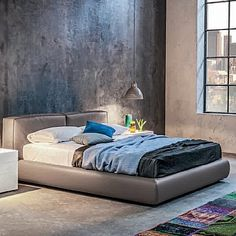 Padded, elegant 'J.P.' bed by Morassutti