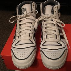 Adidas High Top Sneakers High top sneakers with white laces and black/gray stripes. In pristine condition. Adidas Shoes Sneakers