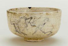 Tea bowl with design of bird on plum branch, unknown Raku ware workshop. 19th century. Edo period.   Raku-type earthenware with cobalt under colorless lead glaze. H: 5.9 W: 10.6 cm. Japan.
