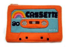 Cassette Tape Pouch - Special Edition Orange Felt 80s Mix Tape. $50.00, via Etsy.