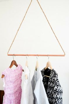"Easiest ""clothes"" rack you'll ever see, made of copper & I think wire cable but the latter might be just a rough & colored piece of rope. You can't exactly put a lot on it but it looks kind of cute ;)"