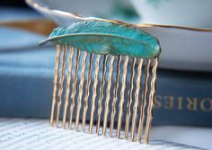 Feather Hair comb - I really think I'm buying this in the next couple of days if i can't talk myself out of it.