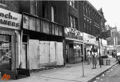 """This view of Brooklyn's Flatbush Avenue, between Caton and Church streets, shows the aftermath of looting and burning of stores during New York City's power failure of """"77.    Photo: AP"""