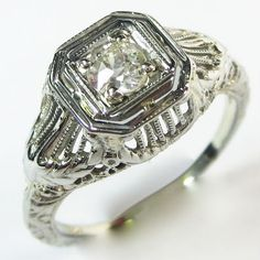 Linear Confection: A lovely old European cut diamond is resplendent in this mounting, which has nice volume on the hand and plenty of frills for lovers of detail. Ca.1935. Maloys.com