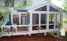 A small extension off this screened porch contains a captured doorway leading out onto the adjacent deck.