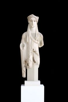 The Kore with the almond-shaped eyes - Slender and expressive, one of the most beautiful Korai on the Acropolis. Around 500 BC. Marble from Paros   Acropolis Museum