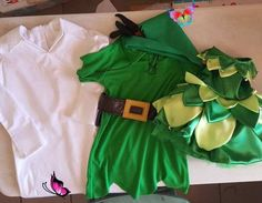 This picture does not do these costumes justice. I was in a time crunch so I didn't have a chance to get models and I haven't gotten pictures from the customer yet. John Darling, Peter Pan and Tinkerbell. These where so fun to make. The Tinkerbell took a lot longer than I thought it would, but I love how it turned out and it's so little... for a little one year old. My 22 yo told me she thought it was the cutest thing I've ever made and asked if I could make one in her size for Halloween… Peter Pan And Tinkerbell, One Year Old, Polo Ralph Lauren, Take That, Models, Costumes, Halloween, Cute, Mens Tops