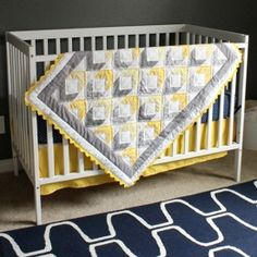 A beautiful baby quilt pattern made with simple half square triangles.