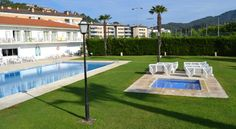 Marina Tossa Tossa de Mar Just a 10-minute walk from Tossa's beaches and walled old town, Marina Tossa offers gardens with a large outdoor pool, tennis court and playground. The modern rooms feature flat-screen TVs.