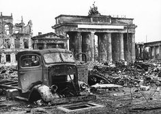Berlin, June 1945: View from Pariser Platz toward the Brandenburg Gate after the German surrender. In the foreground, the skeleton of an American-made truck GMC AFWX 354. Complete and utter devastation.