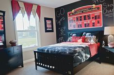 Boy's sports-themed bedroom with scoreboard and chalkboard wall! | Fischer Homes