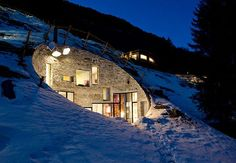 unique house inside a hill side view in winter night. Me want!