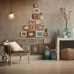 Fill frames with wrapping paper and hang on the wall to create an unconventional tree.
