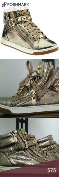 Michael Kors Studded High top Sneakers Worn a few times, like new, no tears.  Please feel free to ask questions   Crackled, foil finish creates champagne sparkle on a statement high-top sneaker finished with pyramid studs.  Adjustable strap with buckle and lace-up closures; side-zip gore.  Leather upper/textile and synthetic lining/synthetic sole.  By MICHAEL Michael Kors; imported.  Women's Shoes. Michael Kors Shoes Sneakers