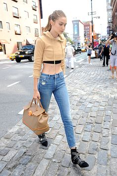 1795233fd99 Supermodel Gigi Hadid looked chic while out in NYC carrying her tan Palazzo  Empire bag with