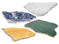 Combining luxurious natural stone with sterling silver and 24-karat gold, these platters are the height of elegant tabletop décor. Use them to display hors d'oeuvres or for pairing a bottle of wine with artisanal cheeses. Master craftsmen in Brazil hand polish the rare stones, and contour their natural edges with precious metals.