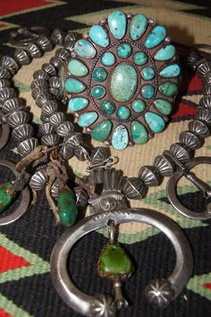 Early Navajo squash blossom and vintage cluster bracelet from Uchizono Gallery.