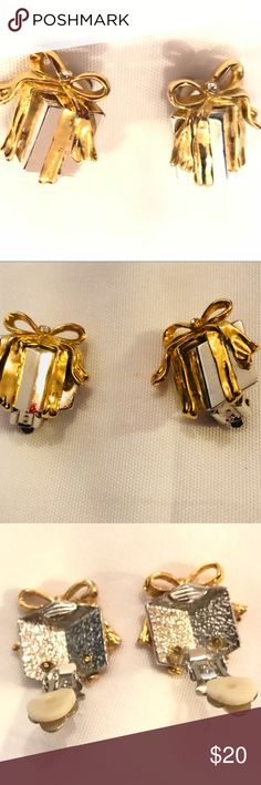 Vintage Christmas Gold and Silver Clip on Earrings Vintage Christmas Gold and Silver Clip on Earrings with one cz each on the ribbons Very comfortable clip on earrings. Looks new for a used pair of earrings. Gorgeous!!! Jewelry Earrings