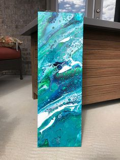 This canvas was created right after a trip to the beach. The blues and greens I used were to capture the many different depths and layers of our oceans. This beautiful, unique and original abstract canvas, was created with a range of blues and greens with a splash of white. I used