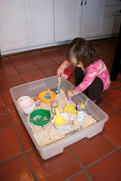 Oatmeal instead of sand. Recycle fruit snack or pudding cups, detergent caps, and spice bottles for pouring and filling. Easy clean up!