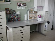 love the color of the wall and the white cabinets with gray desktop