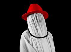 Twistudio - Hidden. Oniric and dark black, white and red photography with hidden face under white veil.